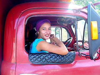 Cuban woman in a truck